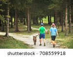 two people walking with dog ... | Shutterstock . vector #708559918