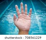 wrinkled hand because of soak... | Shutterstock . vector #708561229