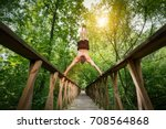 young man doing a handstand on... | Shutterstock . vector #708564868