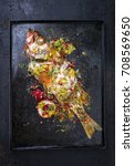 Small photo of Traditional Australian barbecue rose fish with pomegranate and passion fruit as top view on a board