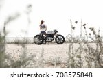 young woman biker with custom...