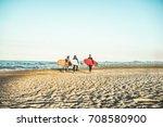 surfer friends walking on the... | Shutterstock . vector #708580900
