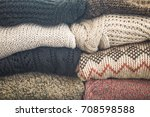 stack of cozy knitted sweaters...   Shutterstock . vector #708598588