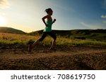 trail runner woman running on... | Shutterstock . vector #708619750