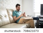 attractive latin man relaxing...   Shutterstock . vector #708621073