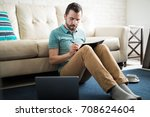hispanic man on his 30s sitting ... | Shutterstock . vector #708624604