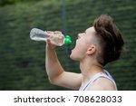teenage boy squirting water... | Shutterstock . vector #708628033