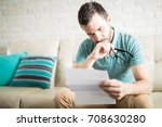worried man reading his mail...   Shutterstock . vector #708630280