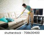 handsome hispanic man using a... | Shutterstock . vector #708630400