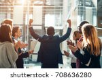 business team celebrating a... | Shutterstock . vector #708636280