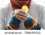 a young man holding a cup of... | Shutterstock . vector #708659323