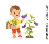 cute little boy picking... | Shutterstock .eps vector #708684604