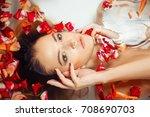 beautiful sexy brunette lying... | Shutterstock . vector #708690703