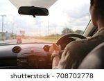 man driver hands holding the... | Shutterstock . vector #708702778