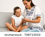 beautiful mom showing to her... | Shutterstock . vector #708715033