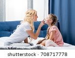 side view of happy mother and... | Shutterstock . vector #708717778