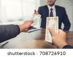 a businessman giving money in... | Shutterstock . vector #708726910