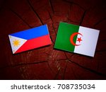 Small photo of Philippines flag with Algerian flag on a tree stump isolated