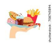 hand with junk food. hand... | Shutterstock .eps vector #708745894