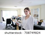 serious young businesswoman... | Shutterstock . vector #708749824