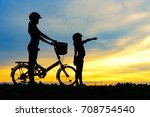 silhouettes of biker family on... | Shutterstock . vector #708754540
