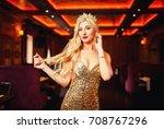 glamorous blonde in golden... | Shutterstock . vector #708767296