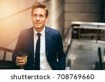 smiling young executive in a... | Shutterstock . vector #708769660