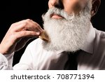 cropped shot of a man combing... | Shutterstock . vector #708771394