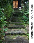 An Old Staircase With Moss On...
