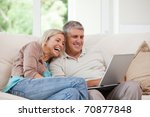 couple looking at their laptop... | Shutterstock . vector #70877848