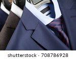 elegant man's suits hanging in... | Shutterstock . vector #708786928