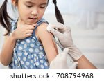 doctor injecting vaccination in ... | Shutterstock . vector #708794968