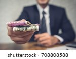 a businessman giving money in... | Shutterstock . vector #708808588