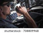 caucasian semi truck driver... | Shutterstock . vector #708809968