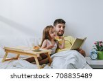 cute little daughter reading a... | Shutterstock . vector #708835489