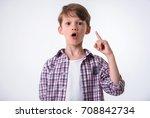 handsome little boy is showing... | Shutterstock . vector #708842734
