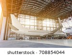 airliner aircraft in a hangar... | Shutterstock . vector #708854044