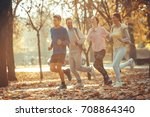group of young friends jogging... | Shutterstock . vector #708864340
