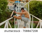 muscular young man during his... | Shutterstock . vector #708867208