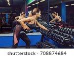slim  bodybuilder girl  lifts... | Shutterstock . vector #708874684