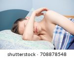 Young caucasian teenage boy asleep in his bed - stock photo