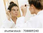 beautiful woman is applying... | Shutterstock . vector #708889240