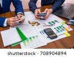 team working talking budget at... | Shutterstock . vector #708904894