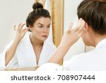 woman cleansing her ears with a ... | Shutterstock . vector #708907444