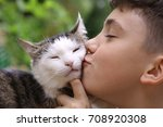 happy boy hold cat smiling... | Shutterstock . vector #708920308