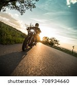 man riding sportster motorcycle ... | Shutterstock . vector #708934660
