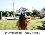 a young girl traveler in a hat... | Shutterstock . vector #708944458