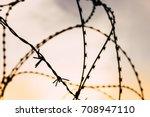 barb wire captivity prison... | Shutterstock . vector #708947110