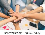 business partners teamwork or... | Shutterstock . vector #708967309