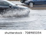 splash by car as it goes... | Shutterstock . vector #708985354